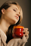 Beverage. Girl holding cup mug of hot drink tea or coffee Stock Photos