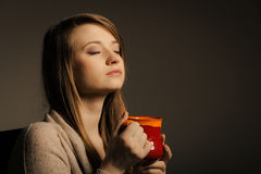 Beverage. Girl holding cup mug of hot drink tea or coffee Stock Photo