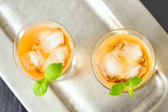 Beverage in a glass. Beverage with ice cubes in glass Stock Image