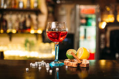 Beverage in glass, lime, lemon, salt and dice Stock Photography
