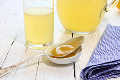 Beverage of honey and lemon in a glass Royalty Free Stock Image