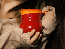 Beverage. Red cup mug of hot drink tea coffee in hands Stock Photos