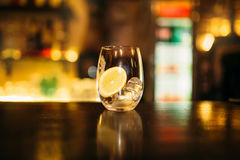 Beverage with slice of lemon and ice cubes Royalty Free Stock Photos