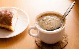 Beverage and sweet food. Cup of coffee and bun. Royalty Free Stock Image