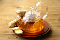 Beverage tea with ginger and fresh root Stock Images