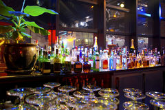 Beverages. Assorted colorful bottles of alcoholic drinks in a night-club Royalty Free Stock Photo
