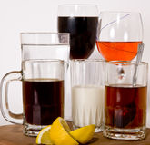 Beverages. Serving a selection of beverages including Water, soda, wine, tea, coffee and milk Stock Photos
