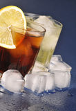 Beverages with ice. Cold beverages with ice cubes and lemon Royalty Free Stock Photography
