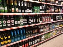 Beverages on supermarket shelves. Bottles on supermarket shelves, alcohol, drink, shopping, mall, center Stock Photography