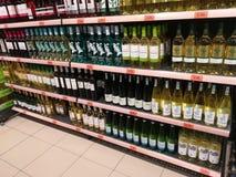 Beverages on supermarket shelves. Bottles on supermarket shelves, alcohol, drink, shopping, mall, center Stock Photo