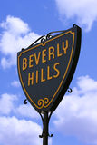 Beverly Hills. Sign in Hollywood, Los Angeles against a blue cloudy sky Stock Images