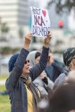 Protect DACA and Dreamers sign held by protester. BEVERLY HILLS, CALIFORNIA - MARCH 12, 2018: A protester holds a sign that reads, ` Protect DACA and Dreamers` Royalty Free Stock Images
