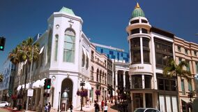 Static shot, of Rodeo Drive, luxury stores and shopping , in Beverly Hills