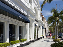 Beverly Hills Rodeo Drive Exclusive Shops. Famous pristine white store fronts along Rodeo Drive in Beverly Hills. Beverly Hills is one of the richest areas in Stock Image