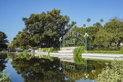 Beverly Hills Sign at Beverly Gardens Park. Beverly Hills, MAR 24: Beverly Hills Sign with reflection on MAR 24, 2017 at Beverly Gardens Park, Los Angeles royalty free stock photography