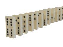 Bevindende domino's Stock Fotografie