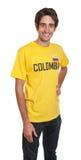 Bevindende kerel van Colombia die bij camera lachen Stock Foto