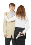 beväpnad manpistolkvinna Arkivfoto