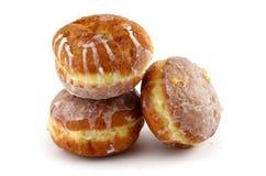 Bevroren donuts op wit Stock Afbeelding