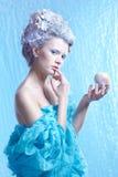 Bevroren fee met appel Stock Fotografie