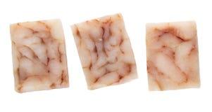 Bevroren gedrukte stukken van pollockfilet die op wit worden geïsoleerd Hoogste mening royalty-vrije stock foto