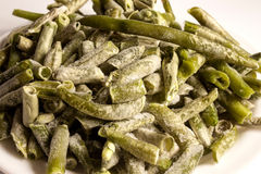 Bevroren groene nierboon op whit Stock Foto's