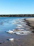 Bevroren overzees strand Stock Foto's