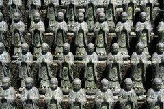 A Bevy of Buddhas. Statues of Buddha from a temple in Shikoku, Japan Stock Photo
