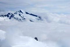 Bewölkte Alpen Stockfotografie