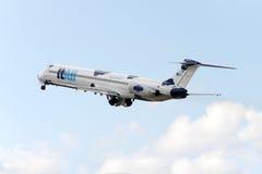 Bewölktes MD-82 Stockfotografie