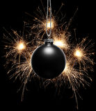 Bew Year background with black Christmas ornament and bengal fireworks Royalty Free Stock Photos