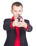 Bewaffneter Bandit betriebsbereit zu schießen Lizenzfreies Stockfoto