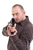 Bewaffneter Bandit betriebsbereit zu schießen stockbilder