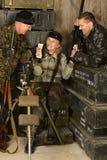 Bewapende gevechtsmilitairen Stock Afbeeldingen