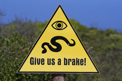 Beware!. Sign warning not to drive over snakes Royalty Free Stock Photography