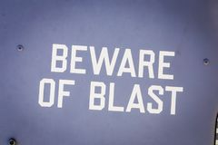 BEWARE OF BLAST. `Beware of blast` warning printed on military aircraft, indicating danger from an engine exhaust royalty free stock photography
