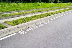 Beware of Buses Sign next to Guided Busway Tracks. Copy space provided royalty free stock images