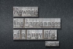 Beware busy life Socrates. Beware the barrenness of a busy life - ancient Greek philosopher Socrates quote made from metallic letterpress on dark background royalty free stock photos