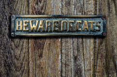 Beware Of Cats Sign On Wooden Door Stock Photography