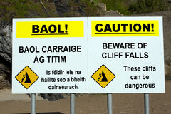 Beware of cliff falls warning sign Royalty Free Stock Photo