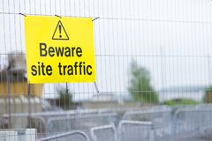 Beware construction site traffic sign on fence. Uk royalty free stock photos