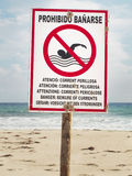 Beware of currents. Signalpost on the beach Stock Photo