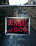 Beware of dog. Sign outside private property stock photos