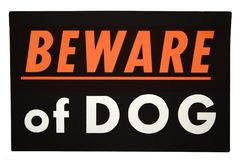 Beware of dog. Black beware of dog sign royalty free stock photography