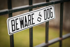 Beware Of Dog. Sign on Black Wrought Iron Fence Royalty Free Stock Photography
