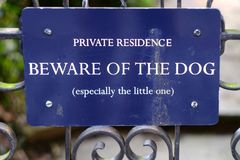 Beware of dog. Beware of the dog, funny gate sign stock photography