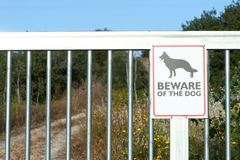 Beware of dog sign on the iron gate,. Guarded object stock photo