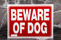 Beware of Dog. A beware of dog sign against a marble background royalty free stock images