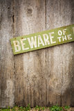 Beware Of Dog Sign on Old Worn Wood Fence Royalty Free Stock Photo