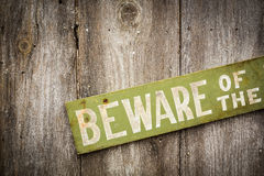 Beware Of Dog Sign on Old Worn Wood Fence Royalty Free Stock Image